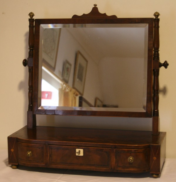 A rectangular Regency toilet mirror