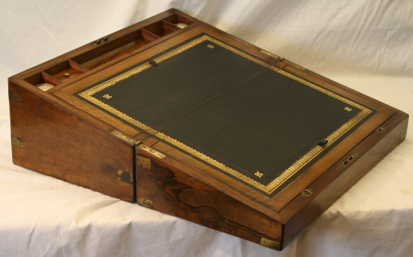 A Victorian walnut and brass bound writing slope