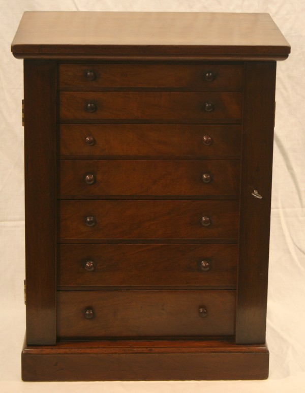 A Victorian walnut miniature Wellington chest
