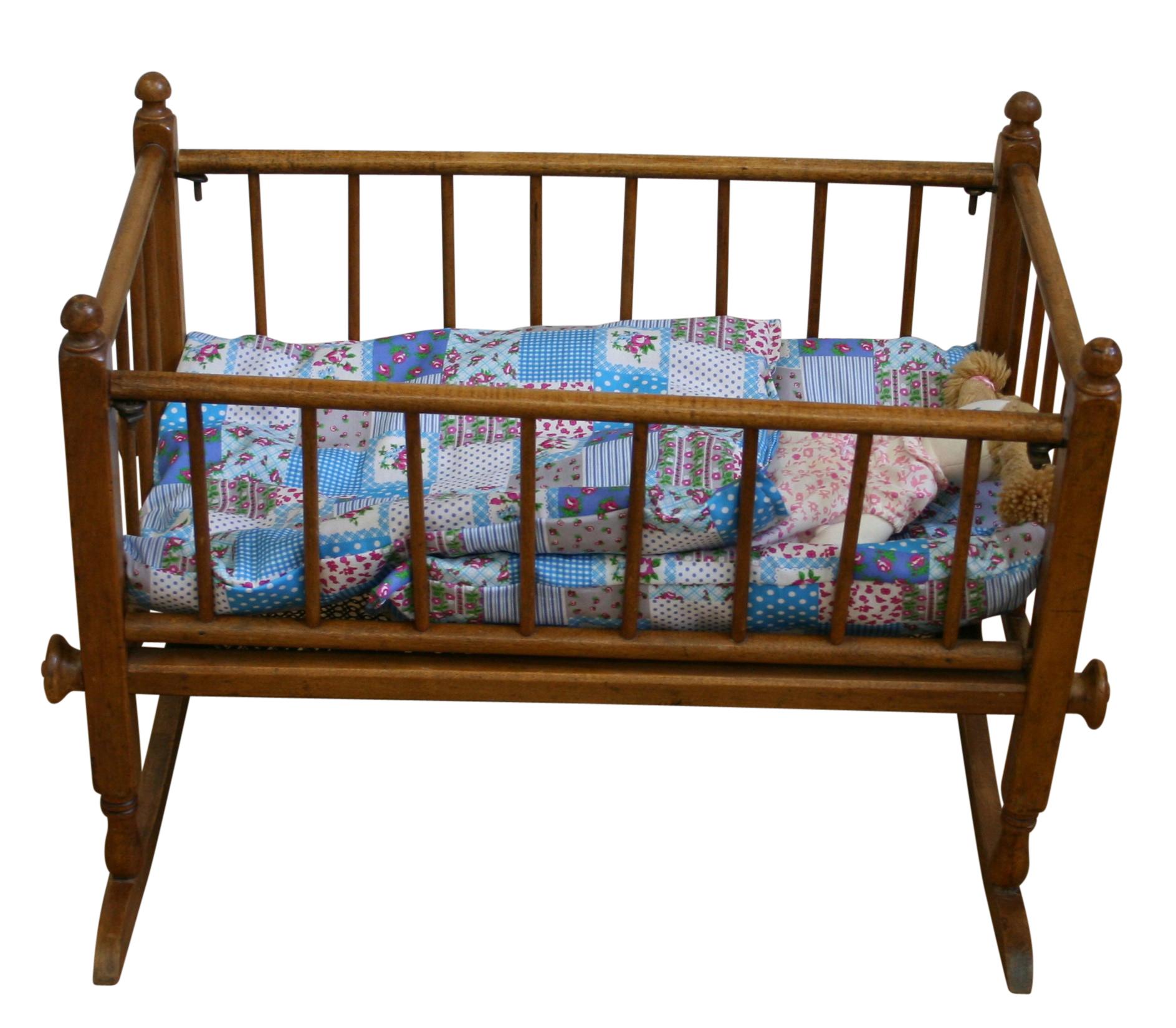 an antique edwardian beech toy crib