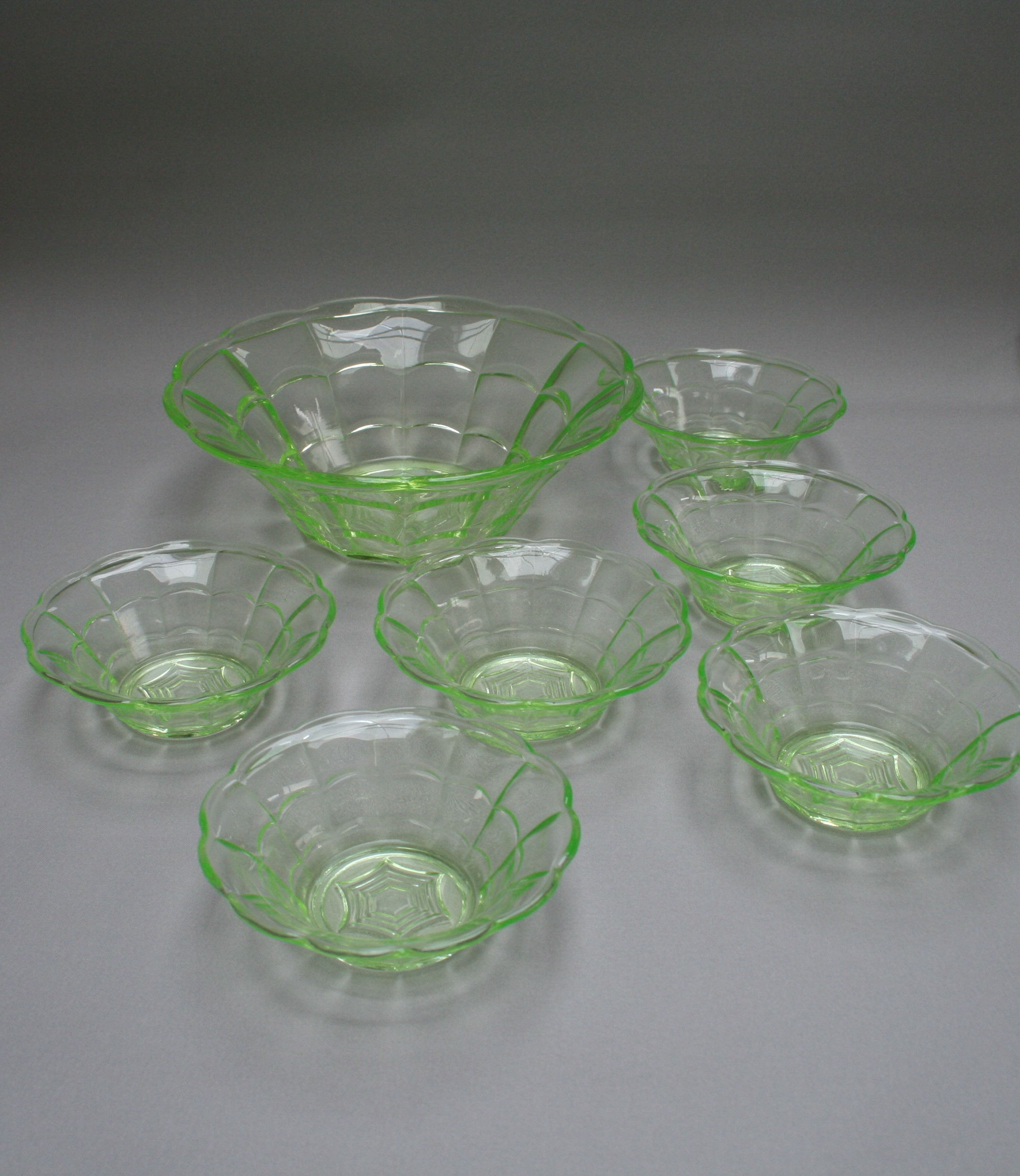 An Antique Serving Bowl And Six Dessert Bowls Made From
