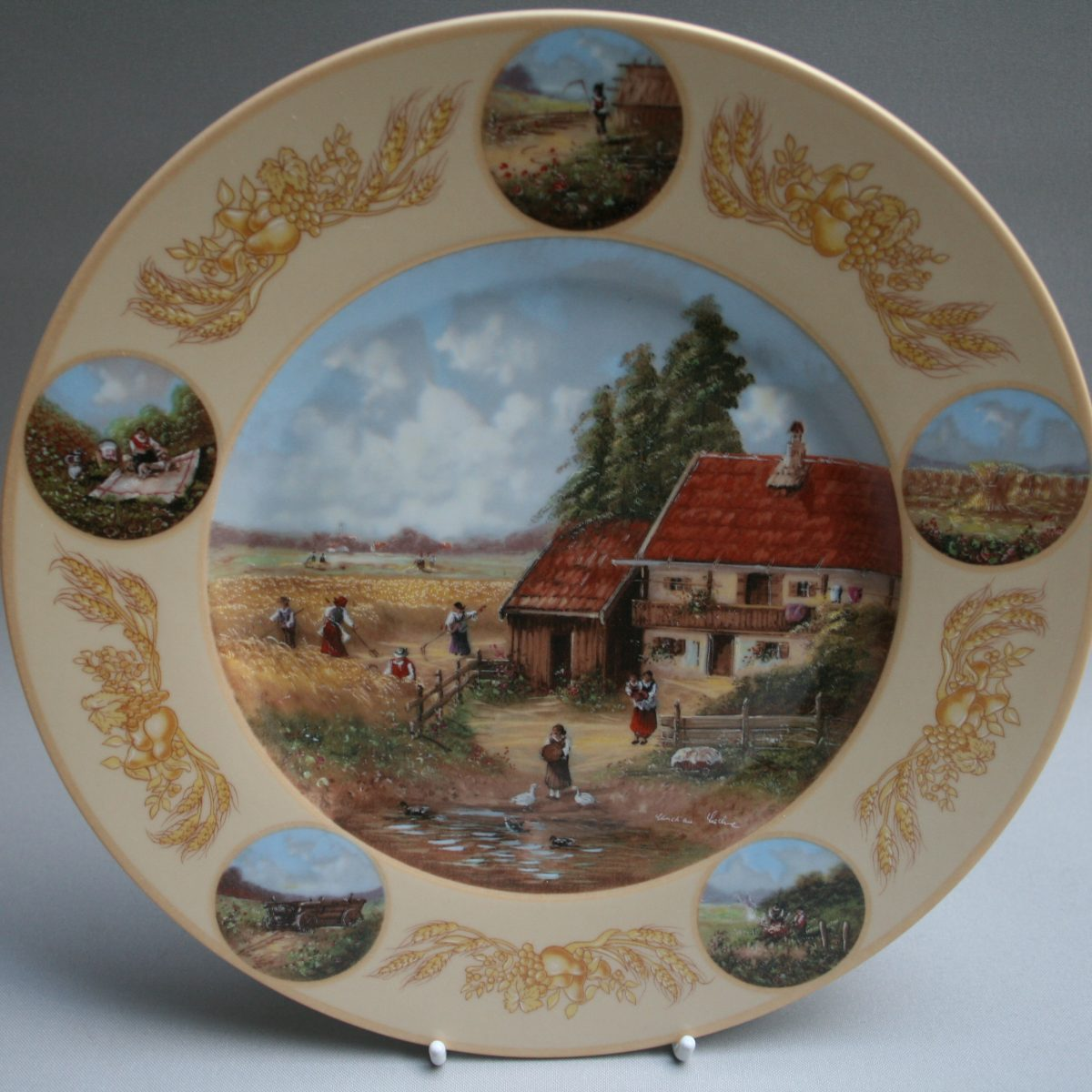 Four decorated plates by Christian Luckel/williamsantiques