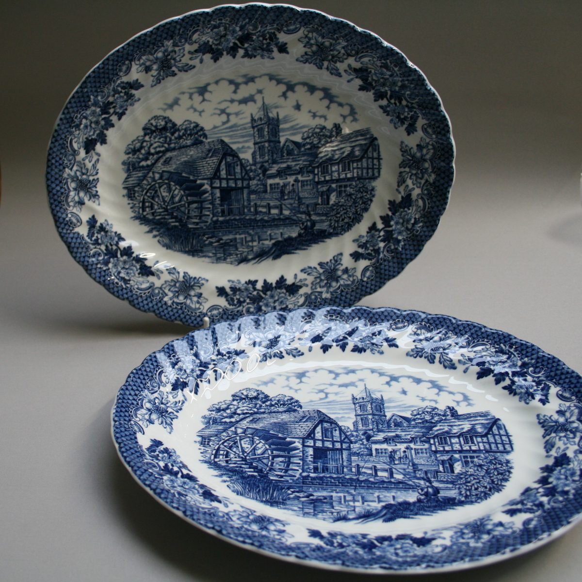 pair of blue and white oval serving dishes with the Merrie olde England design/williamsantiques