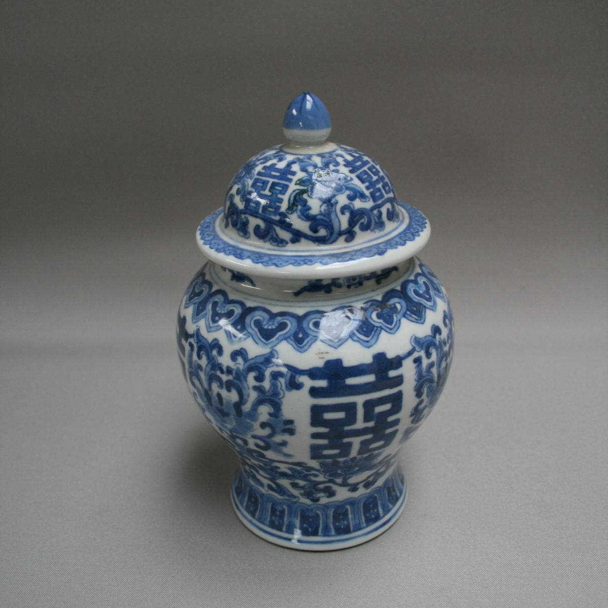 A blue and white lidded vase