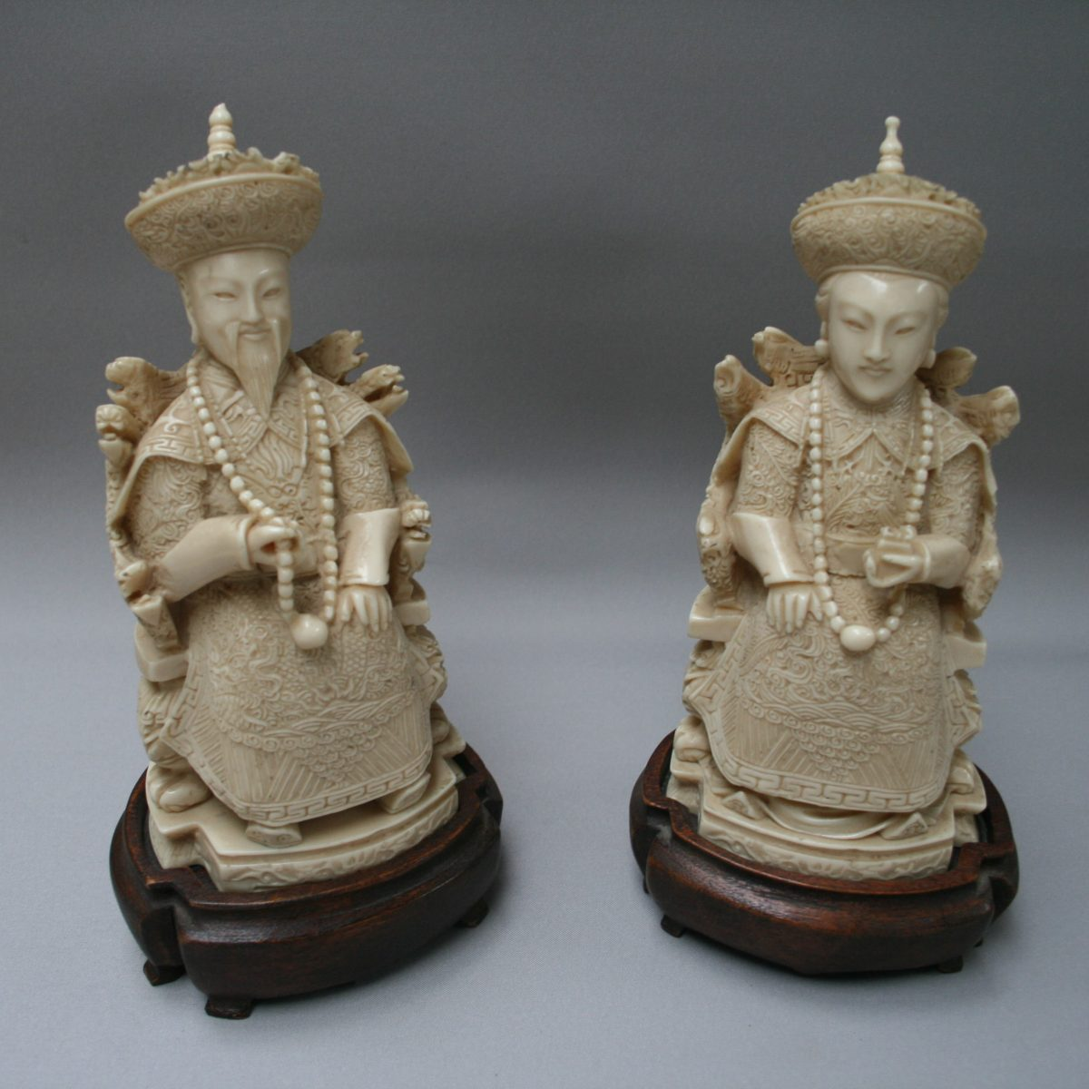 pair of carved Chinese Emporer and Empress statues/williamsantiques