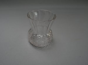 glass posy vase with dimpled body