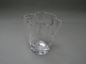 A glass posy vase with frilly edge