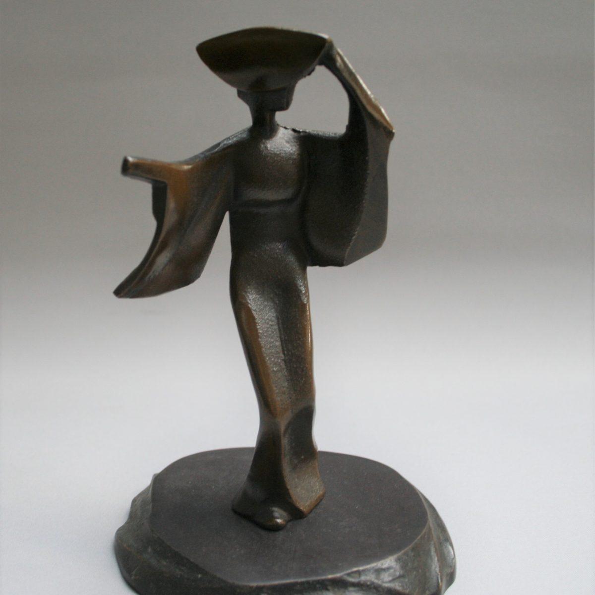 cast iron sculpture of a geisha/williamsantiques