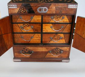 oriental table cabinet in a parquetry design/williamsantiques