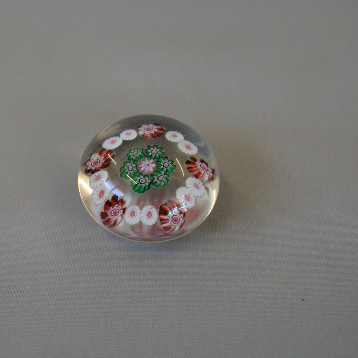small round glass paperweight