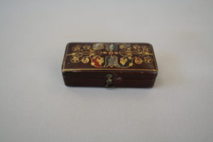 rectangular jewellery box covered with a maroon embossed paper/williamsantiques