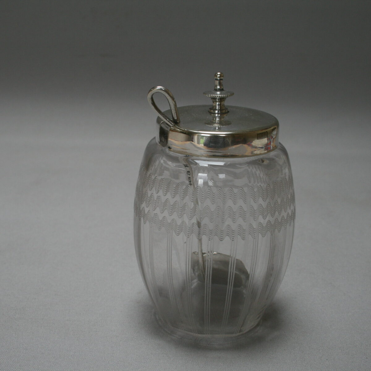 glass jam jar with silver spoon/williamsantiques
